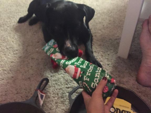Corrina opening gifts